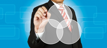 relate: Businessman drawing intersected circle diagram Stock Photo