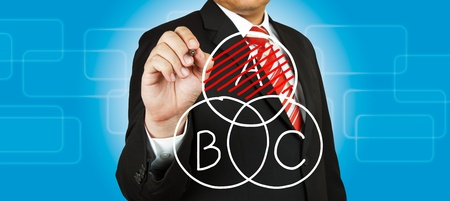 Businessman drawing intersected circle diagram and shadow the distinct A Stock Photo - 14854493
