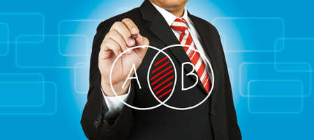 Businessman drawing intersected circle diagram and shadow the intersection Stock Photo - 14854483