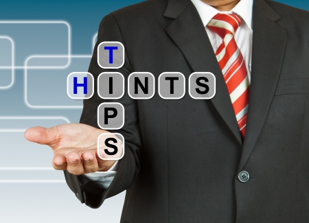 hints: Businessman hand drawing Tips and Hints Stock Photo