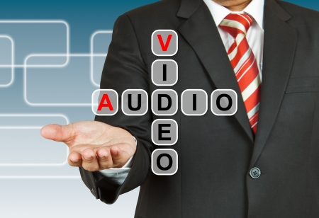Businessman hand drawing Video and Audio