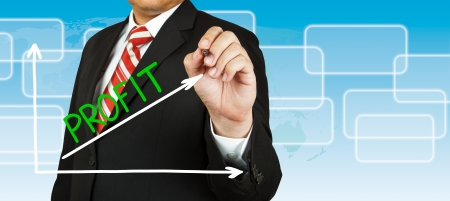 Businessman drawing a graph with Profit going up photo