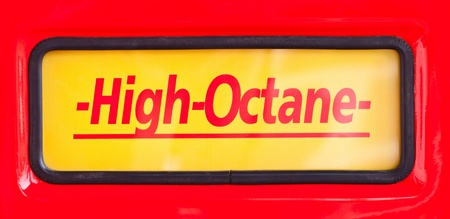 High Octane sign at classic fuel pump on red background photo