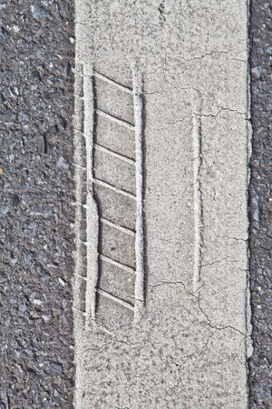 Close up tire track on road line photo