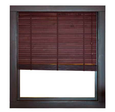 Wooden window frame with bamboo blind photo