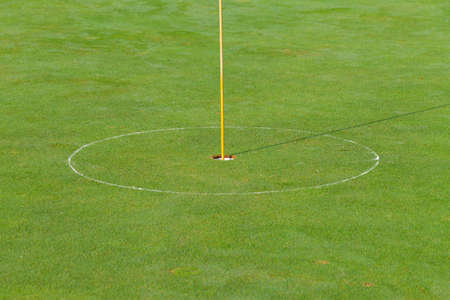 Golf hole and flag with the green grass Stock Photo - 16579932