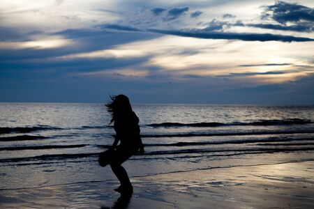 Silhouette girl on beach photo