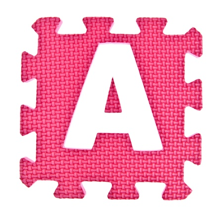 Alphabet toy piece isolated on white background photo
