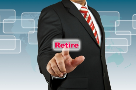 retire: Businessman push Retire button Stock Photo