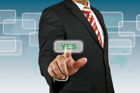 Businessman push Yes button Stock Photo - 17177384
