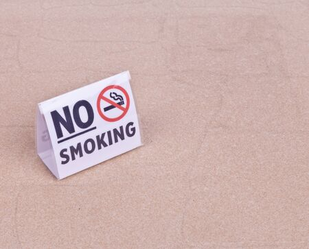 No Smoking sign on table Stock Photo - 17606021