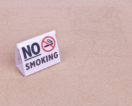 No Smoking sign on table Stock Photo - 17606021