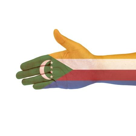 comoros: Comoros flag on hand isolated on white background Stock Photo