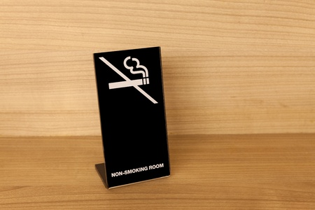 No Smoking sign on wooden table photo