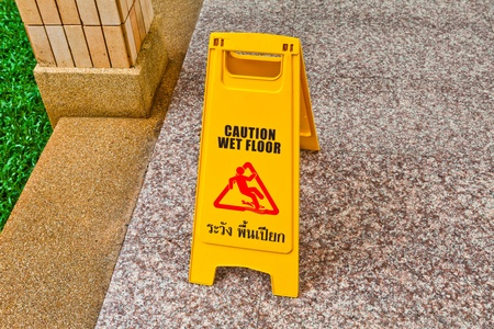 Wet floor caution sign on floor photo