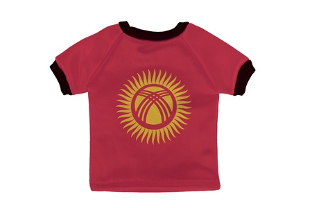 kyrgyzstan: Small shirt with Kyrgyzstan flag isolated on white background Stock Photo