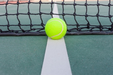 Tennis court with ball closeup photo