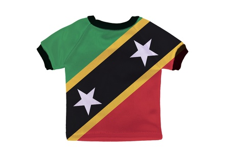 Small shirt with Saint Kitts and Nevis flag isolated on white background photo