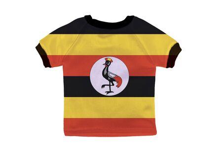 Small shirt with Uganda flag isolated on white background photo