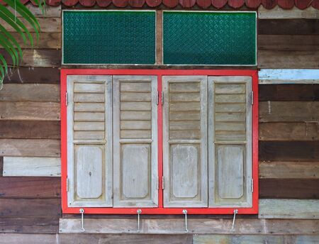 closed windows on rural wooden house photo