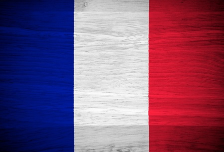 french flag: France flag on wood texture