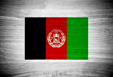 afghanistan flag: Afghanistan flag on wood texture
