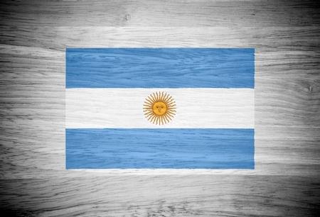 argentina flag: Argentina flag on wood texture Stock Photo