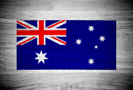 Australia flag on wood texture photo