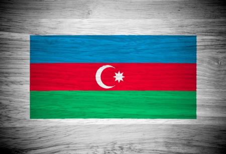 Azerbaijan lag on wood texture photo