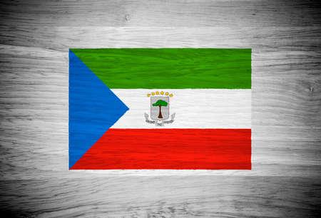 equatorial guinea: Equatorial Guinea flag on wood texture