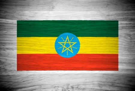 ethiopia flag: Ethiopia flag on wood texture