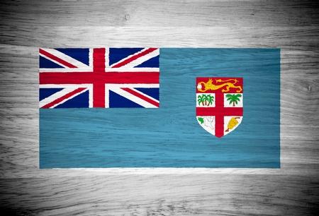 fiji: Fiji flag on wood texture Stock Photo