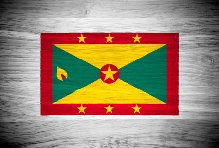 grenada: Grenada flag on wood texture