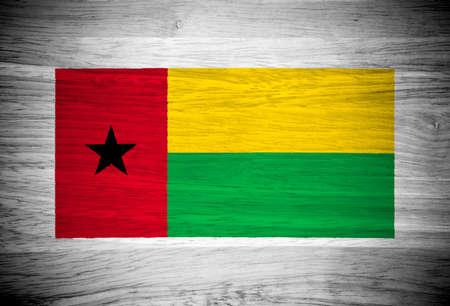 guinea bissau: Guinea Bissau flag on wood texture