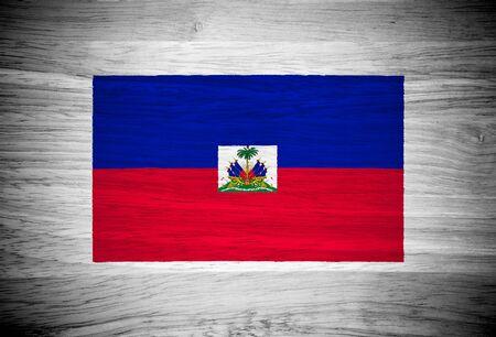Haiti flag on wood texture photo