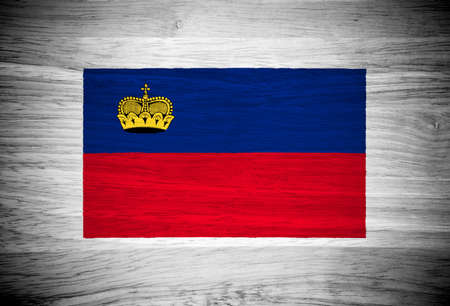 liechtenstein: Liechtenstein flag on wood texture Stock Photo