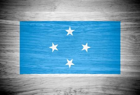 micronesia: Micronesia flag on wood texture 스톡 사진
