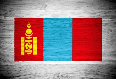 mongolia: Mongolia flag on wood texture