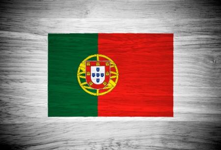 Portugal flag on wood texture photo
