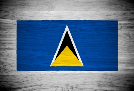 Saint Lucia flag on wood texture Stock Photo - 21943392