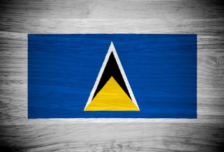 Saint Lucia flag on wood texture Stock Photo - 21943392