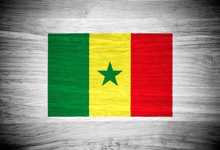 Senegal flag on wood texture photo