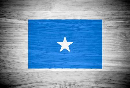 somalia: Somalia flag on wood texture