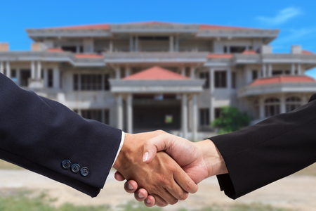 Businessman handshake for real estate business photo