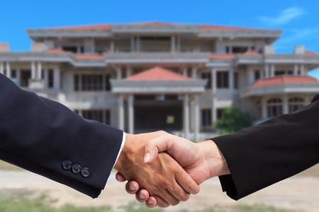 Businessman handshake for real estate business