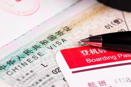 パスポートと搭乗券で中国ビザ 写真素材