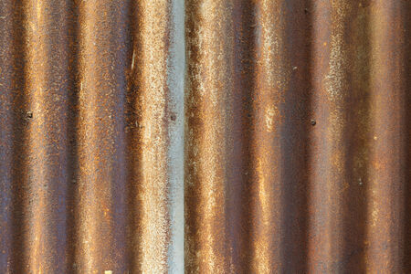 Rusty old corrugated iron fence close up photo