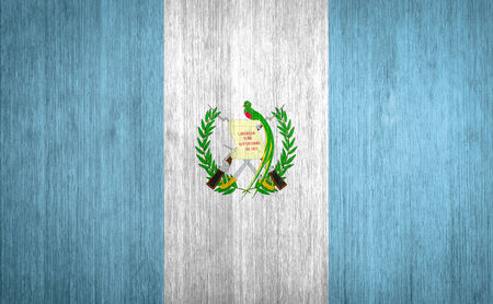 Guatemala Flag on wood background photo