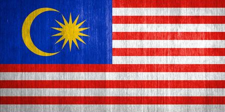 Malaysia Flag on wood background photo