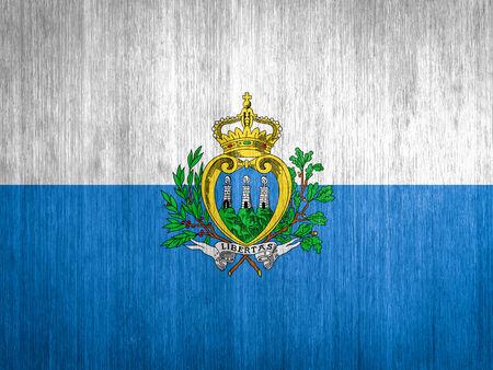 San Marino Flag on wood background photo